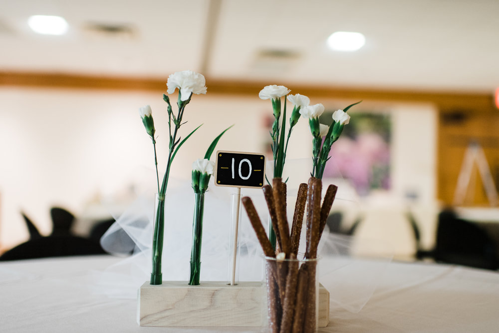 Mini chalkboard table number in a wooden stand.