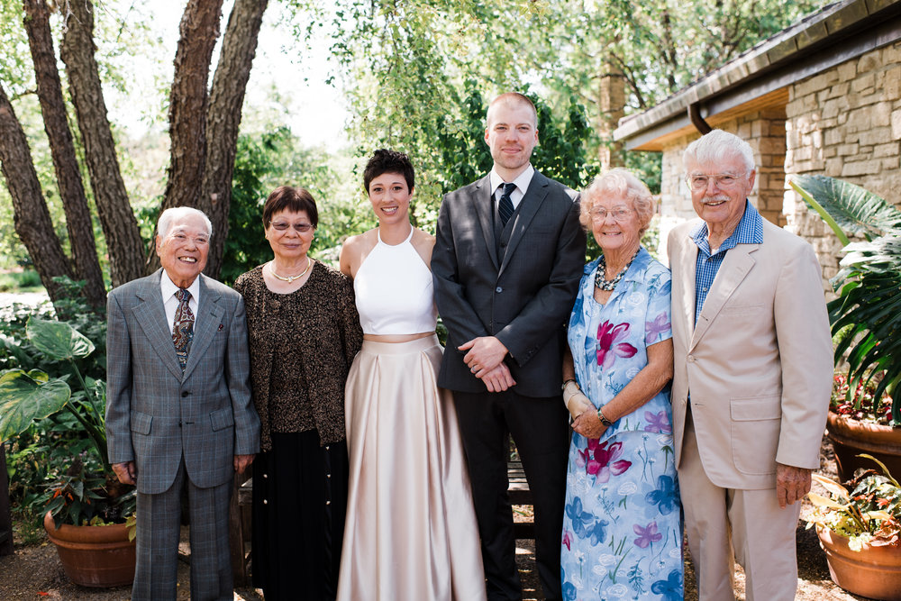 Bride and groom with their grandparents.