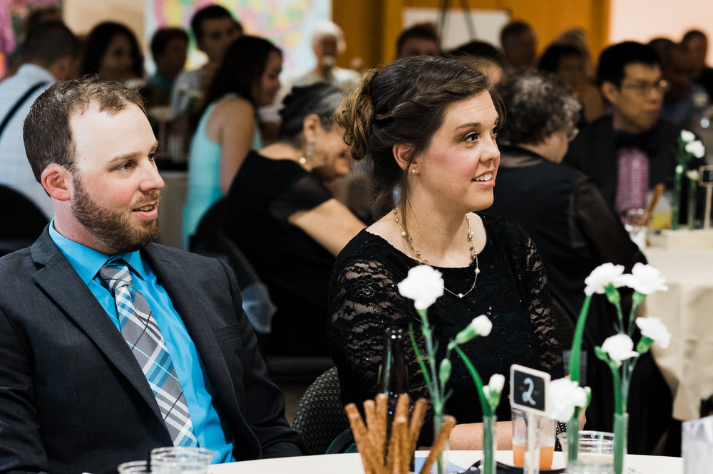 Wedding guests listening to speeches.