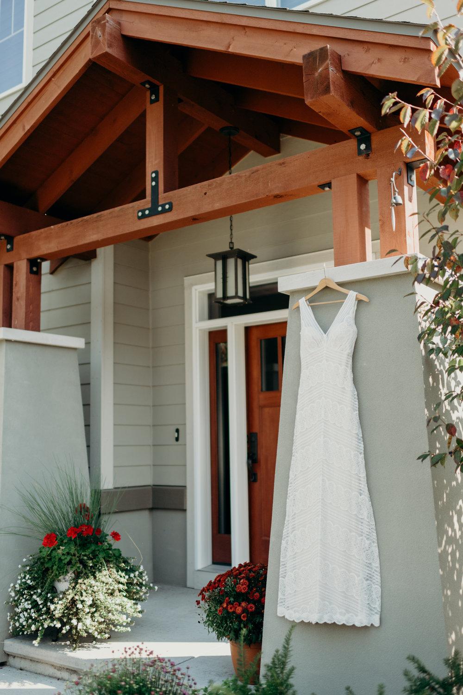 Wedding dress hanging on a pillar.