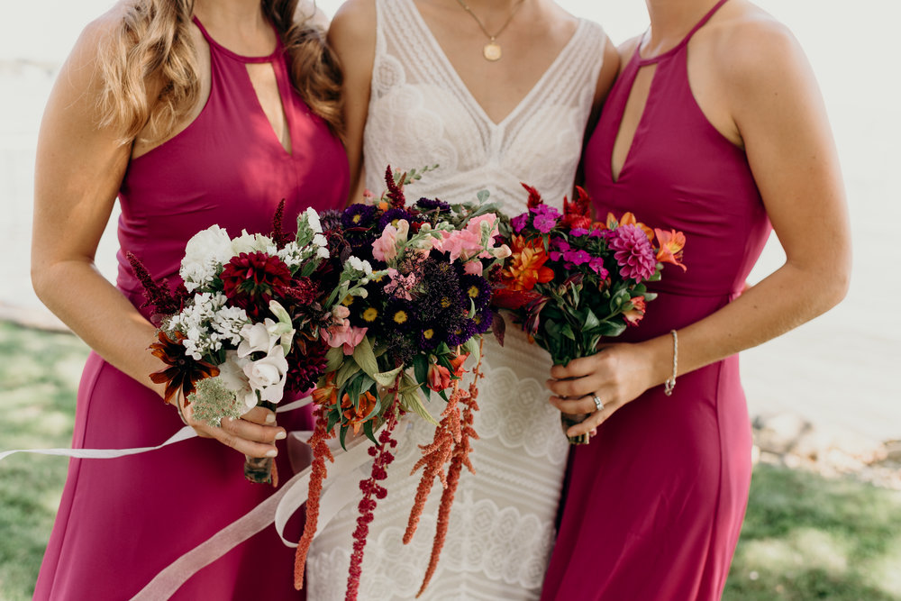 Bride and bridesmaids holding their bouquets.