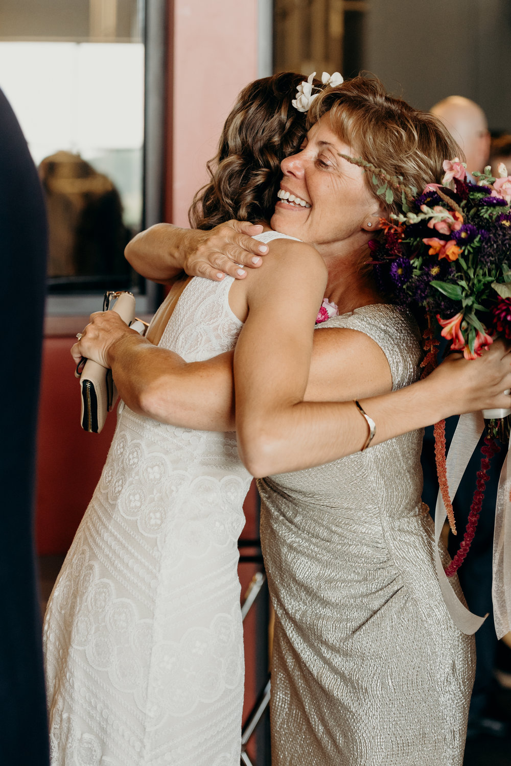 Mother of groom hugs her new daughter-in-law.