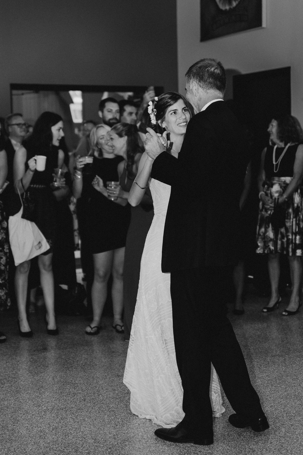 Black and white of bride dancing with her father.