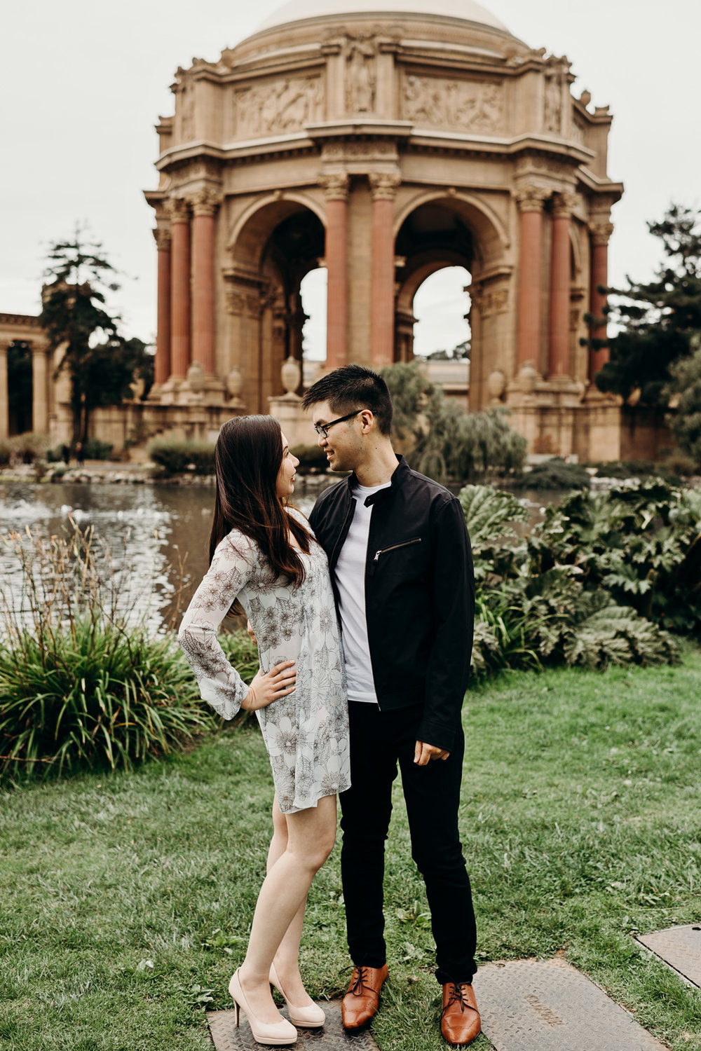 Engaged couple looking at each other at Palace of Fine Arts Theatre.
