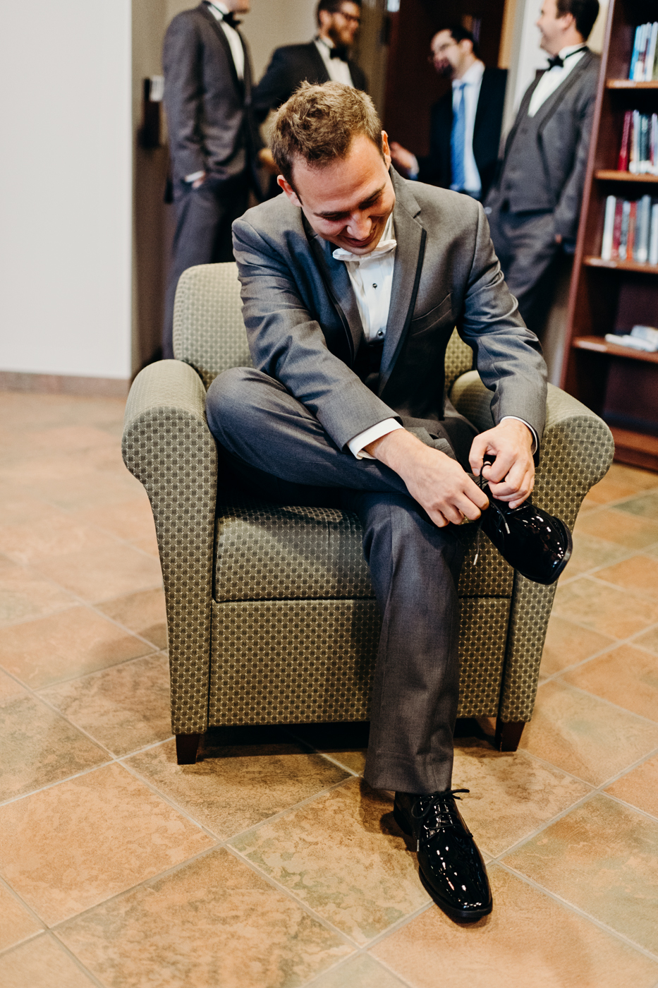 Groom ties his shoes