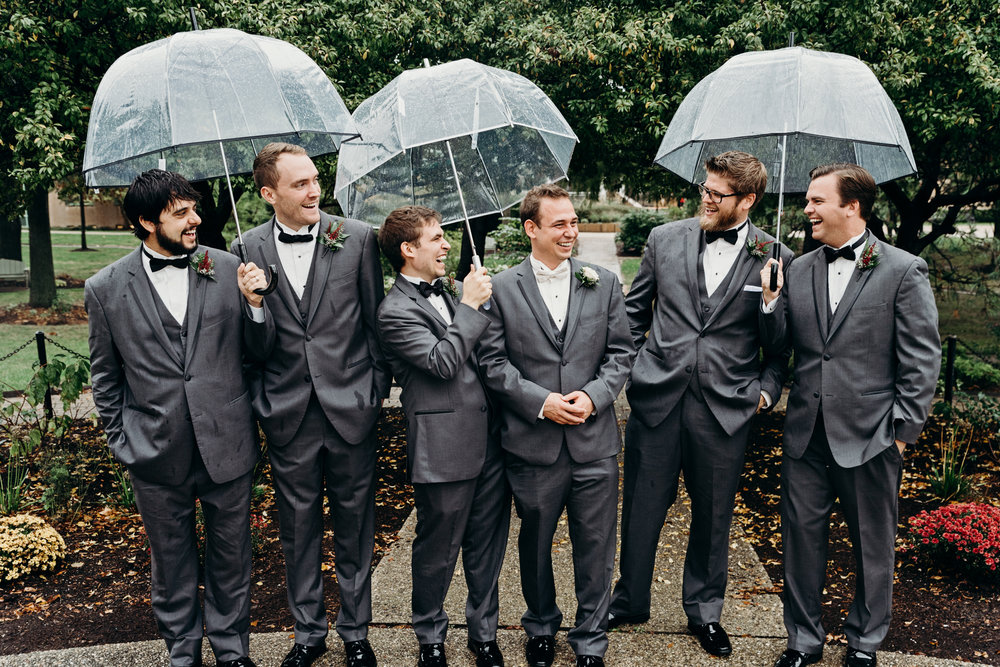 Groom laughs with his groomsmen