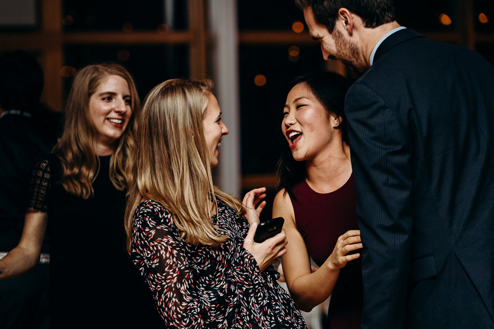 Women smiling at each other at wedding reception