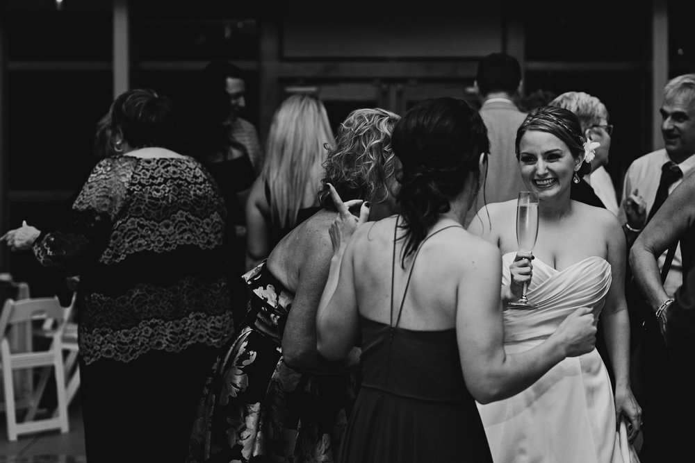 Bride smiles on the dance floor at her wedding reception