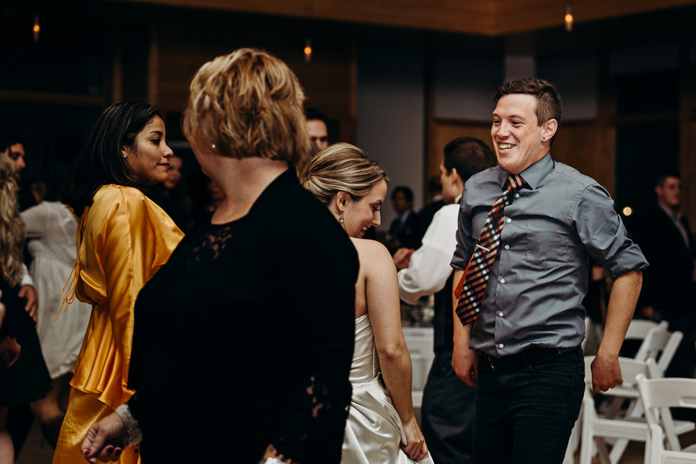 Wedding guest smiling and dancing