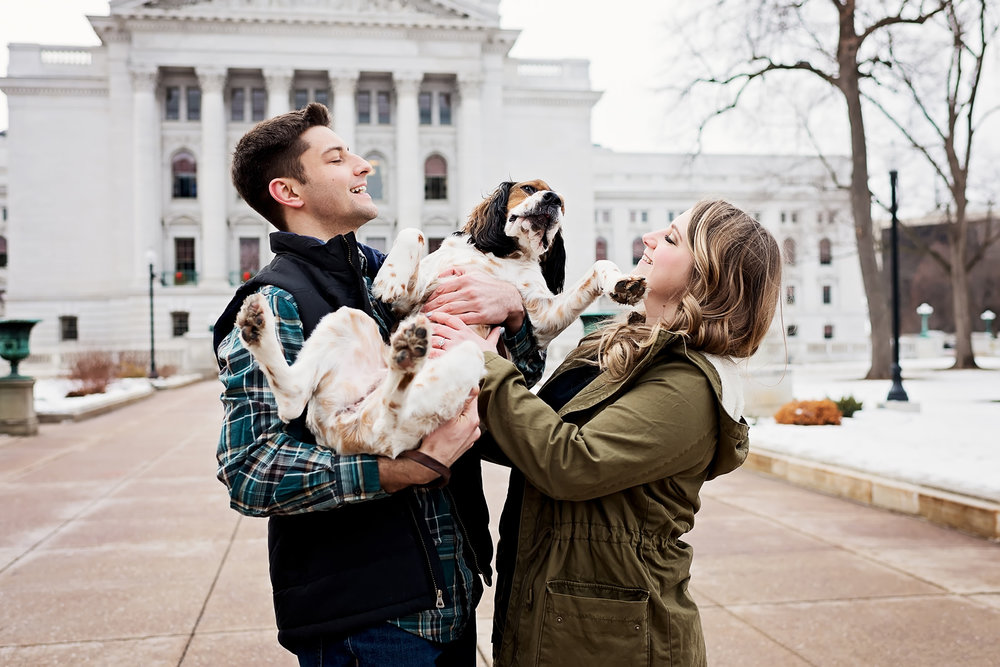 Couple holding dog