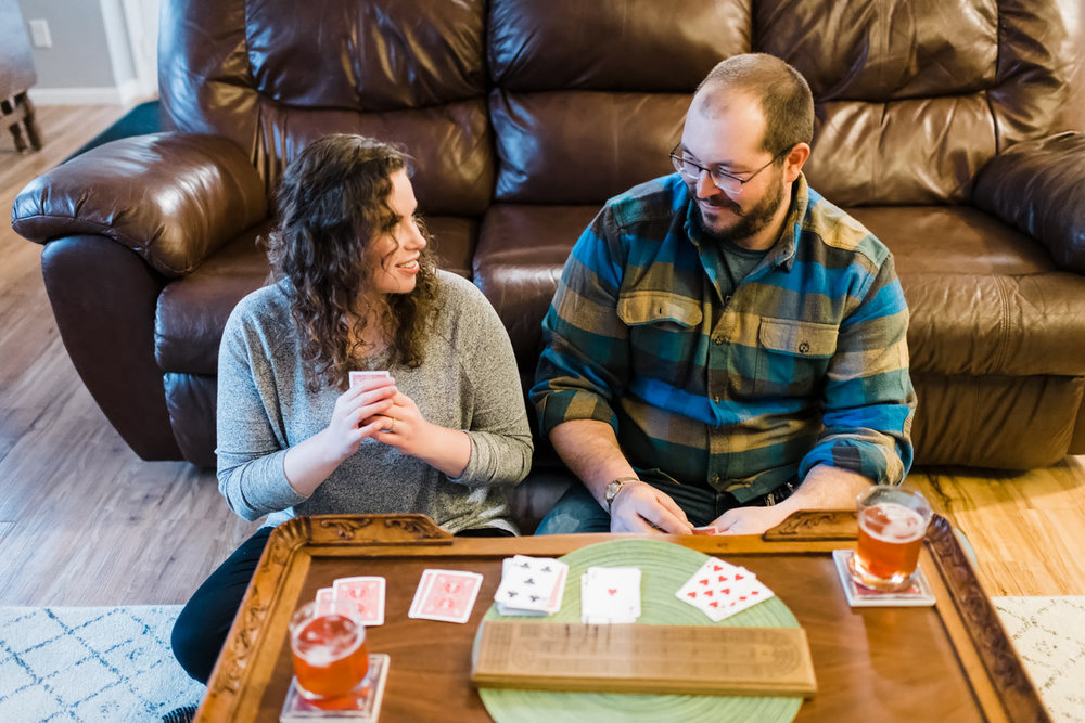 Couple playing cribbage in their home