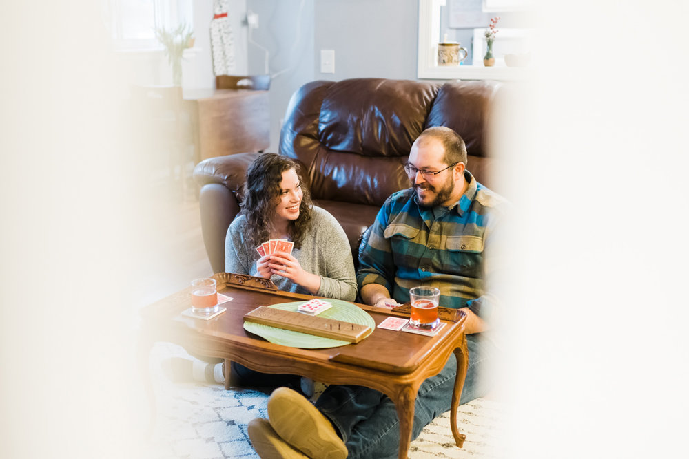 Couple smiling while playing cribbage