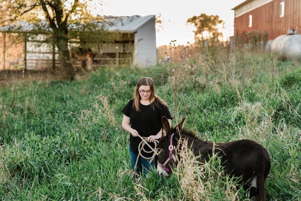 High school senior walks with her donkey