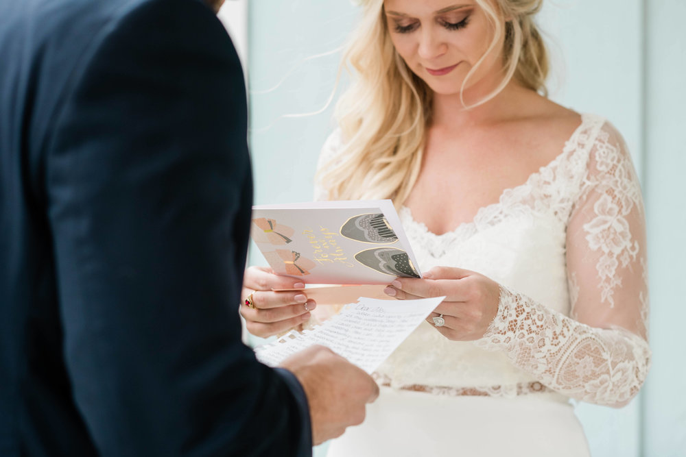 Bride and groom reading letters to each other