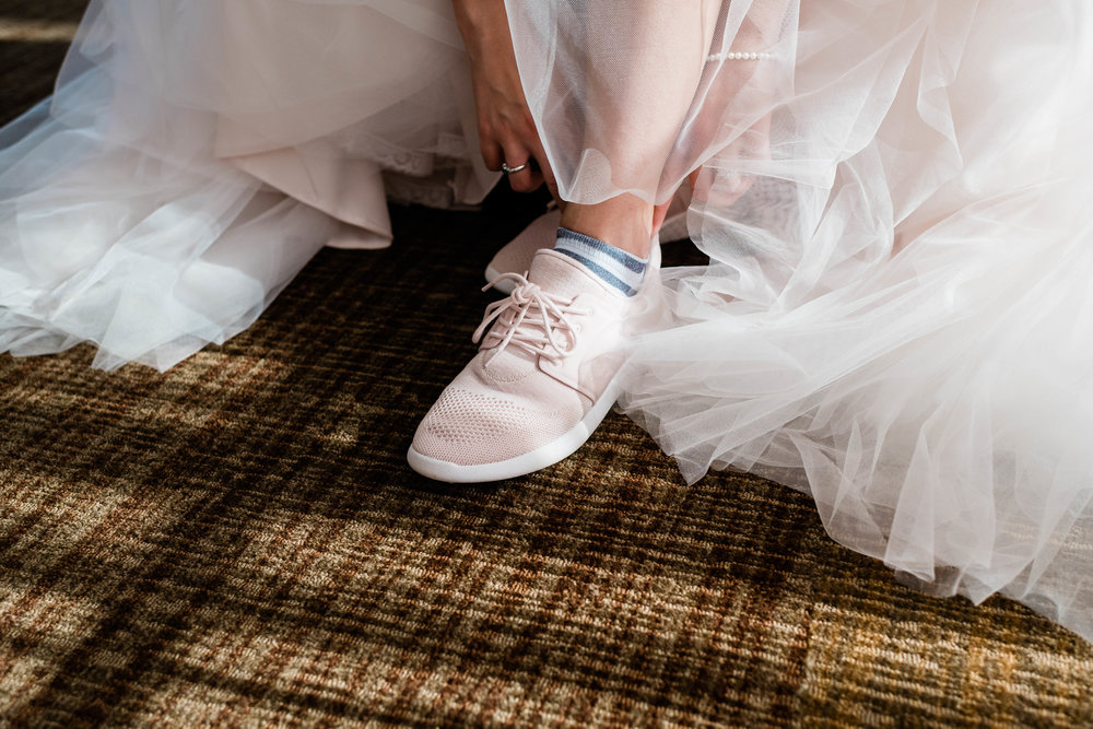 Bride putting on her tennis shoes