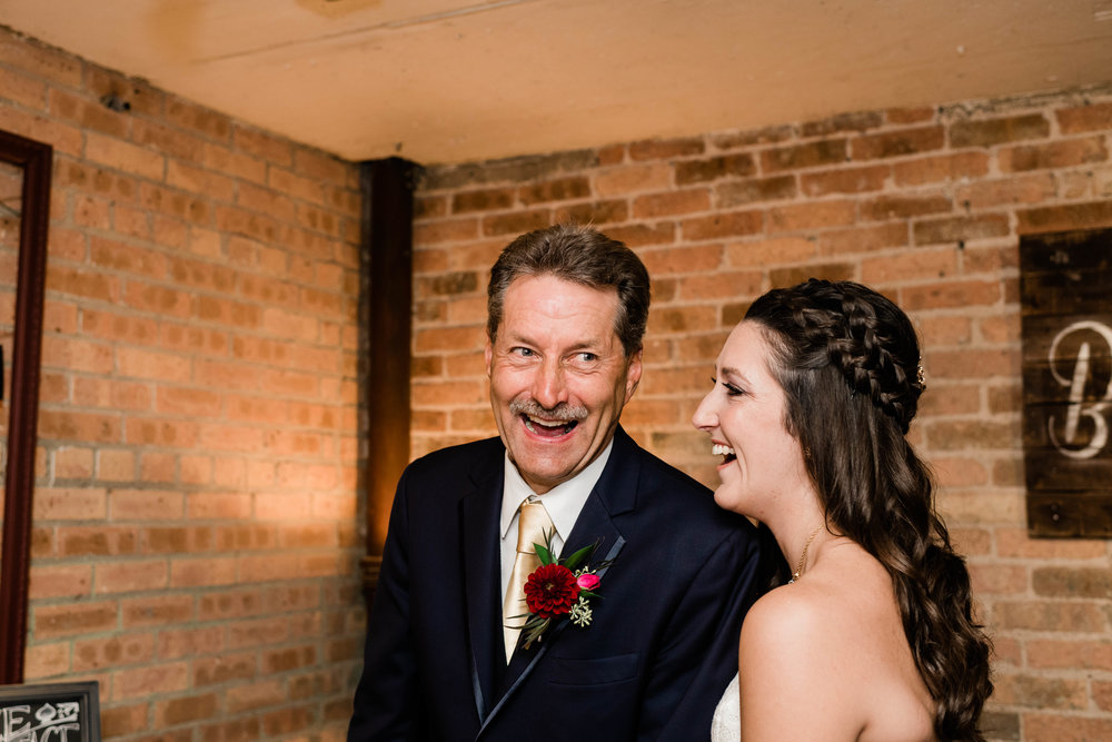 Bride and her father laughing