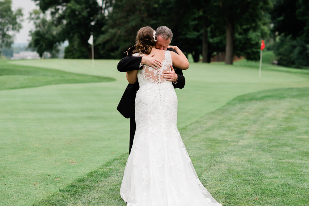 Dad hugs his daughter on her wedding day