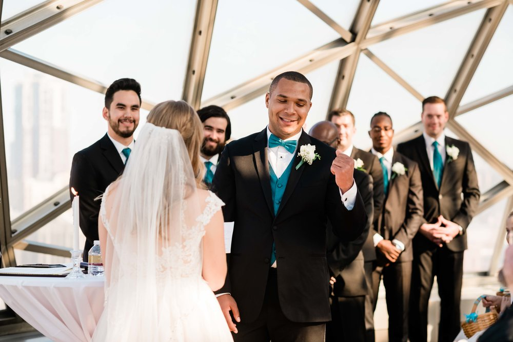 Groom does a fist pump during the ceremony