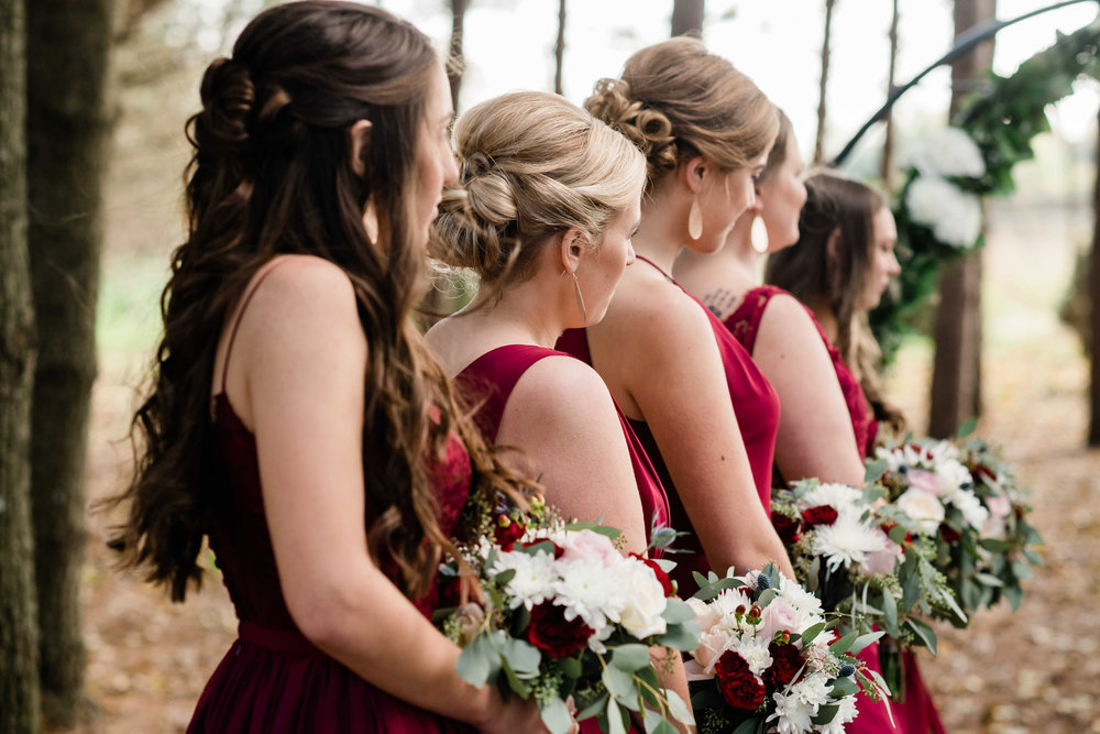 Bridesmaids lined up during ceremony