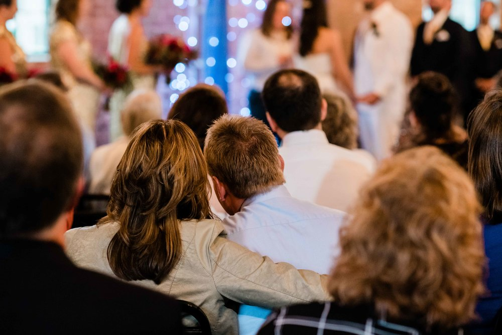 Wedding guests snuggling during the ceremony