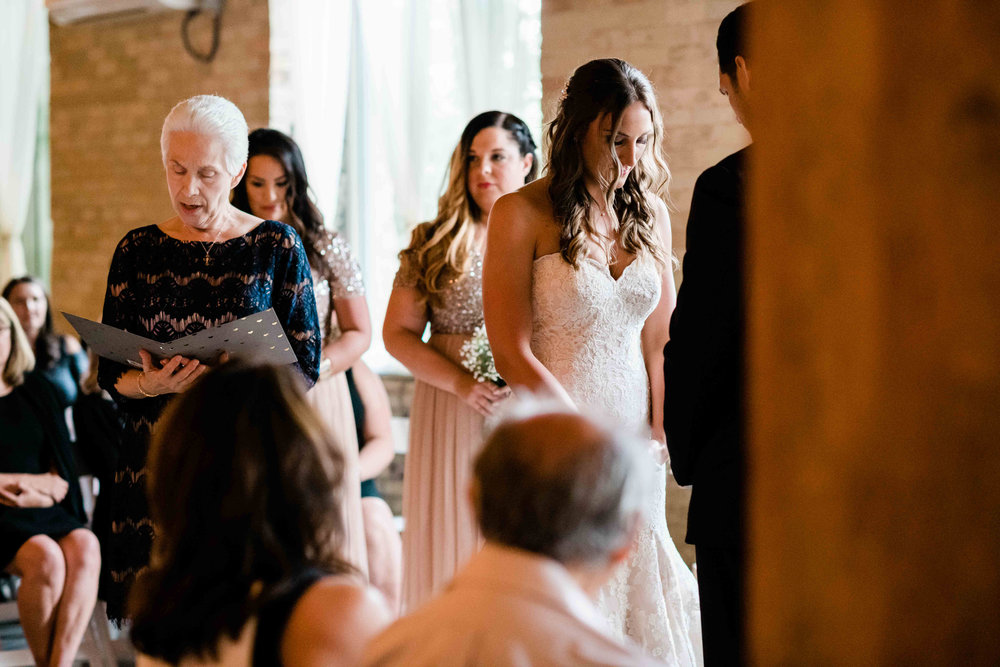 Mother of the bride saying a prayer before wedding ceremony