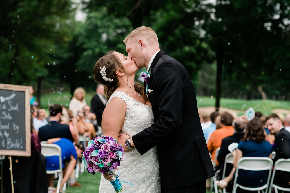 Bride and groom kiss after their wedding ceremony