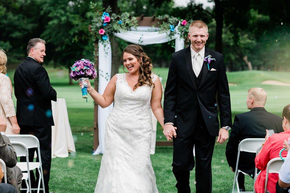 Bride and groom wedding ceremony bubble exit