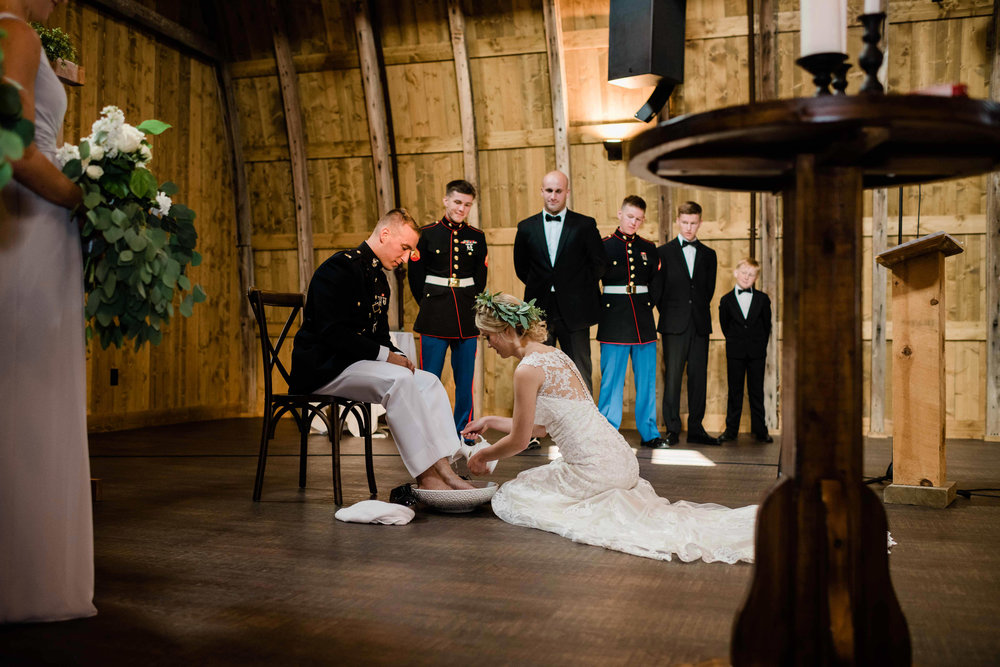 Bride and groom during foot washing ceremony