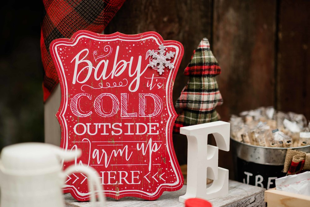 Baby it's cold outside sign for outdoor winter wedding