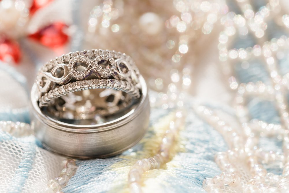 Wedding rings on sparkly dress