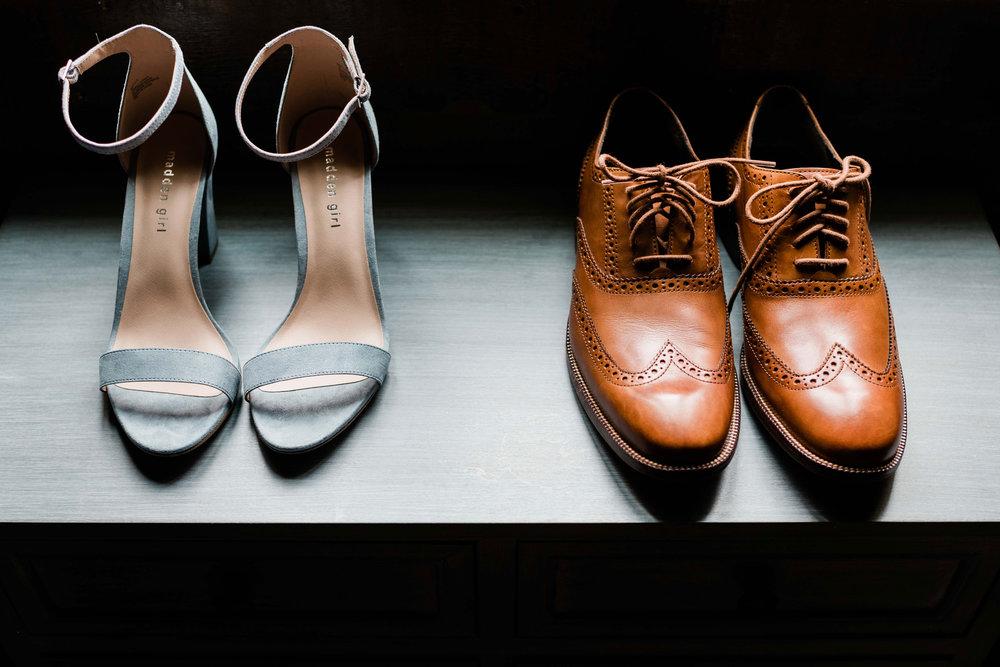 Bride and groom shoes on dresser