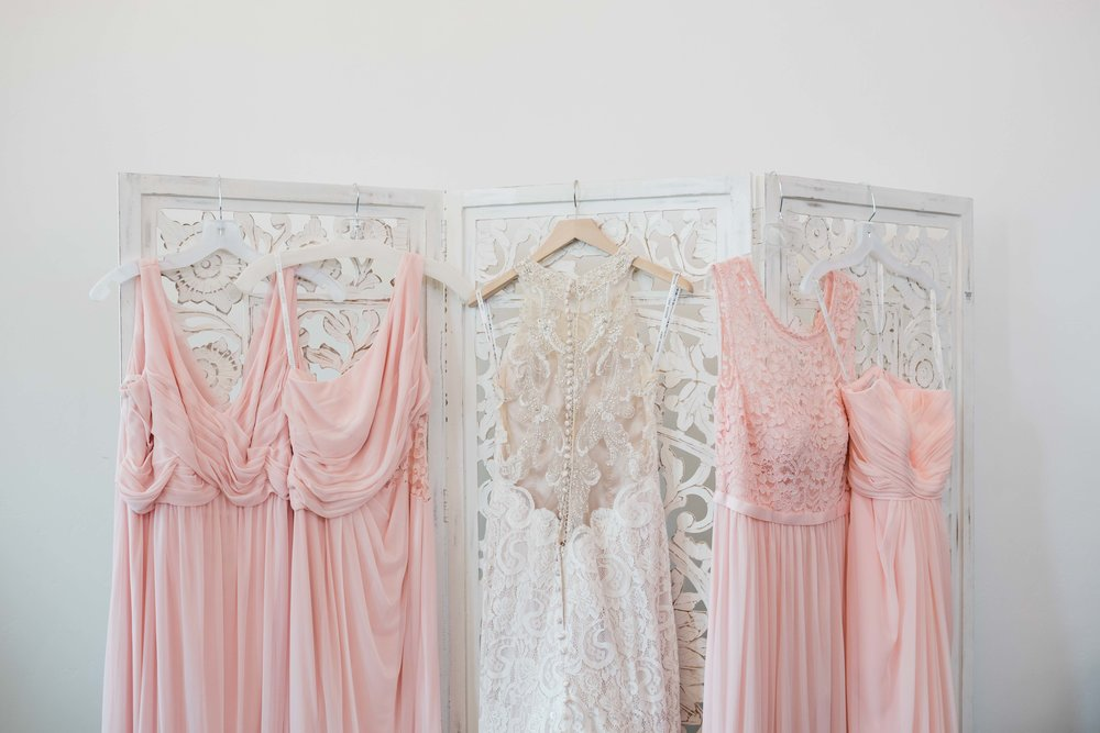 Bridal and bridesmaids gowns hanging up