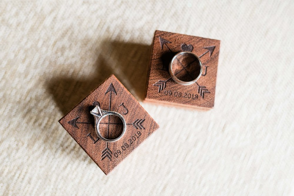 Wedding rings on personalized wooden ring boxes