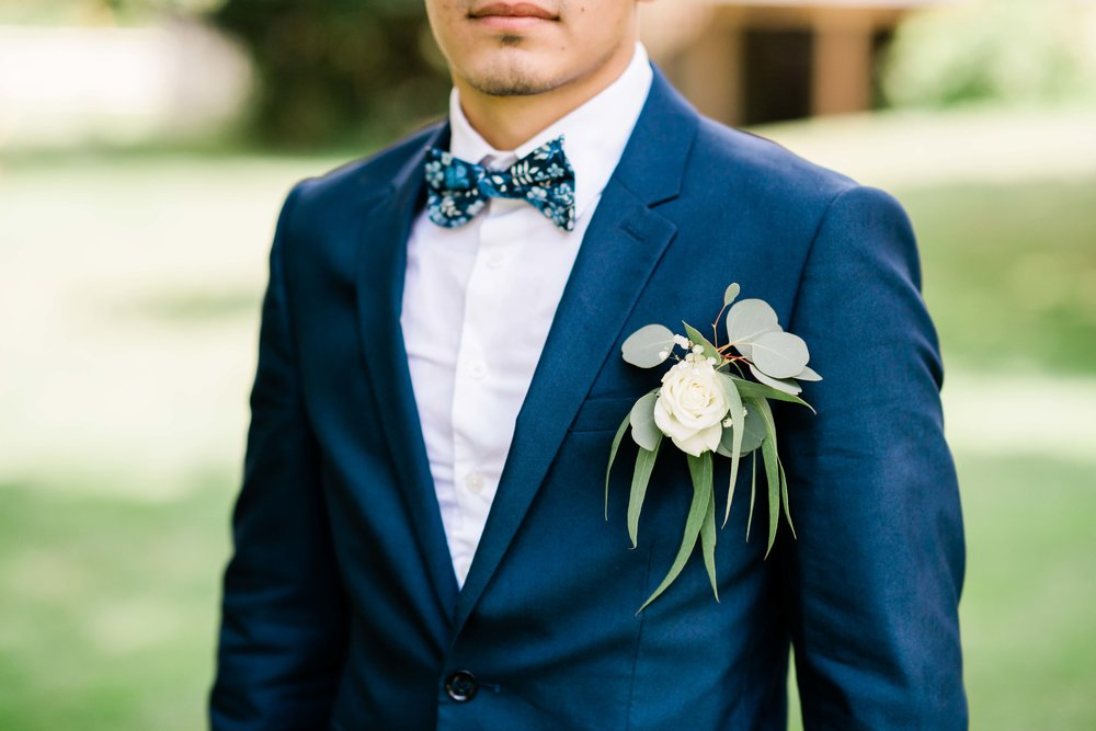 Groom wearing his boutonnière