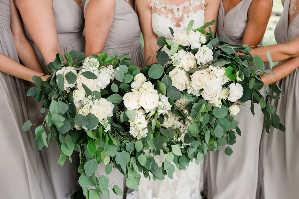 Wedding party holds their bouquets