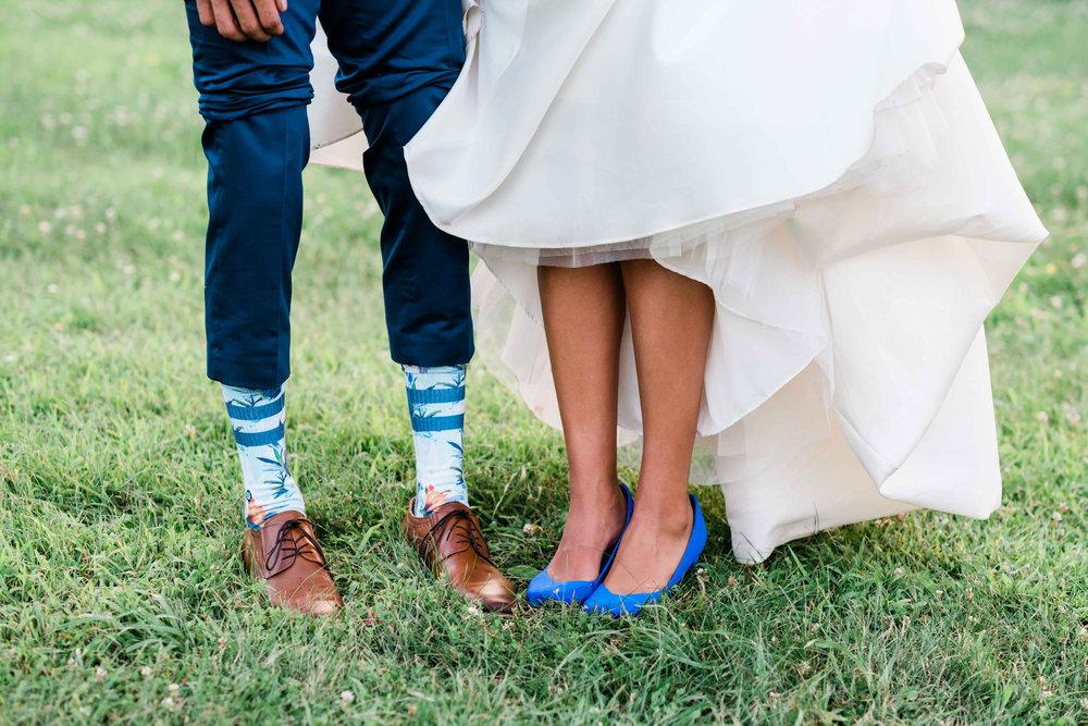Bride and groom showing their footwear