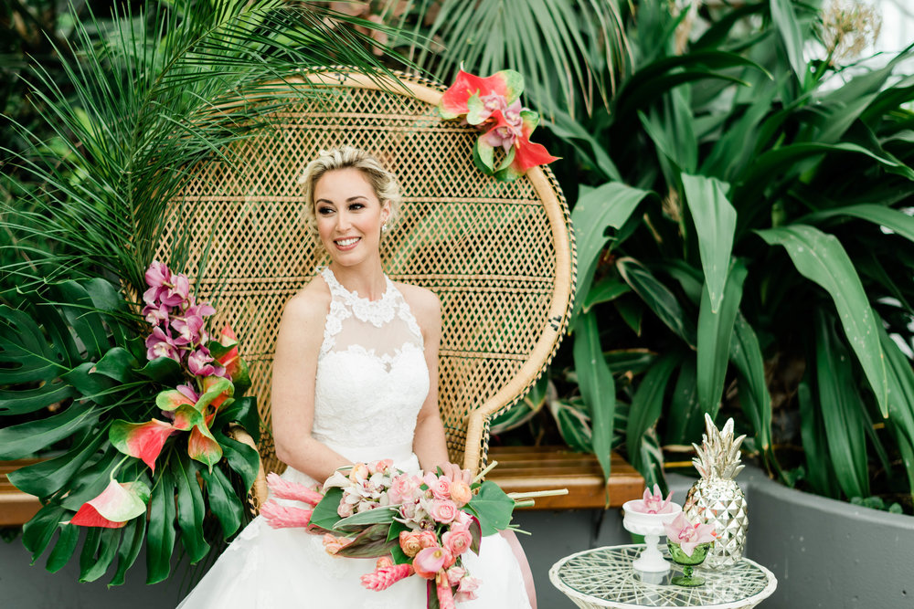 Bride sitting in peacock chair