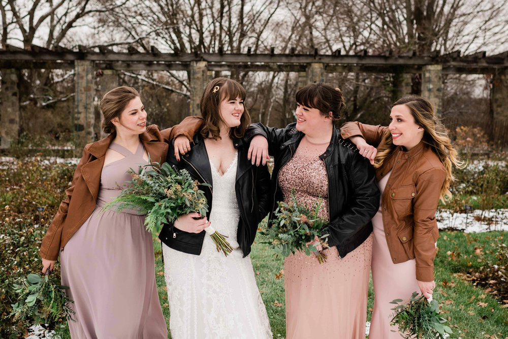 Bride and bridesmaids casually laughing with each other