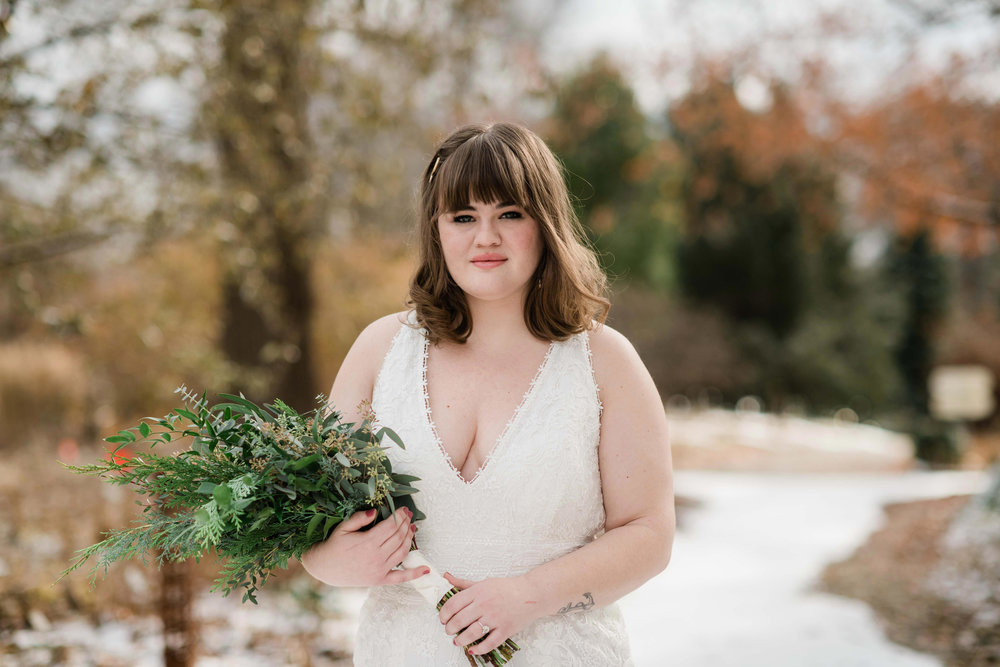 Bride holding her bouquet with a serious expression