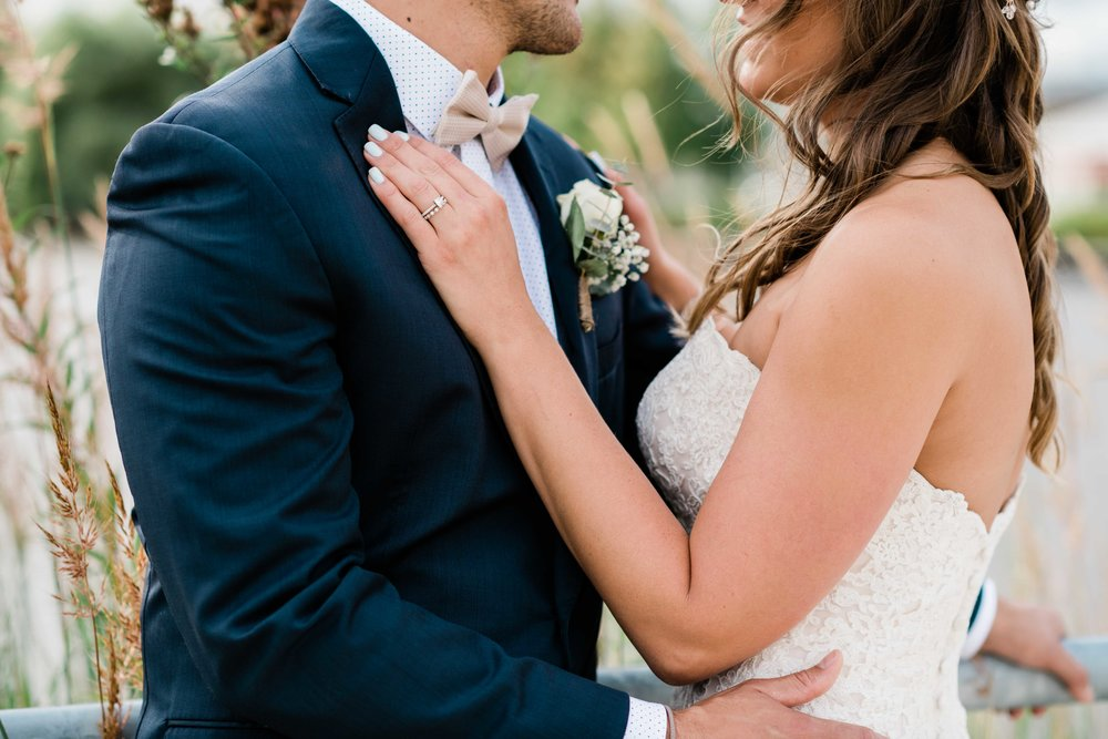 Bride rests her hand on groom's chest