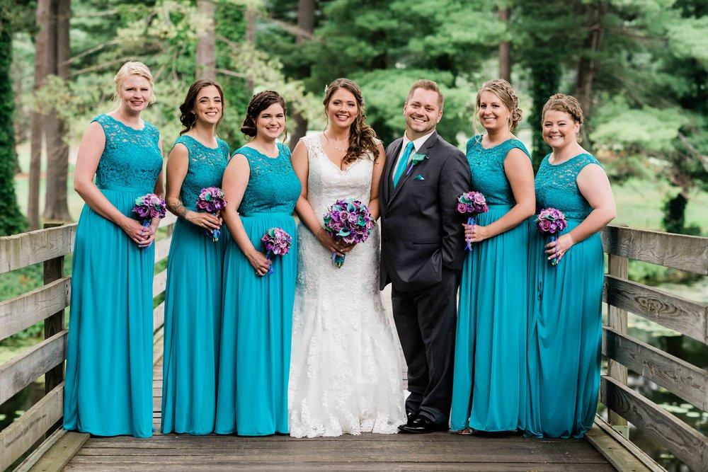 Bride and bridal party on a bridge
