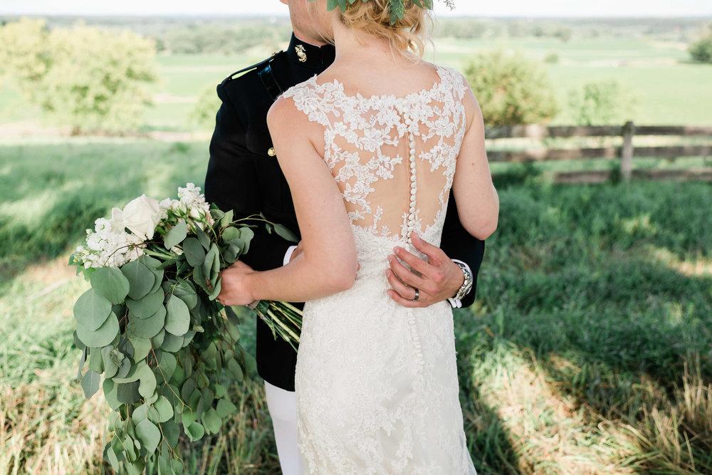 Groom gently holds bride's back