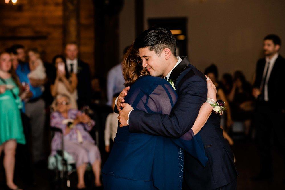 Groom hugs mom