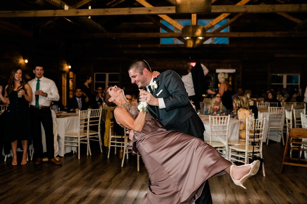 Groom dips his mom during dance