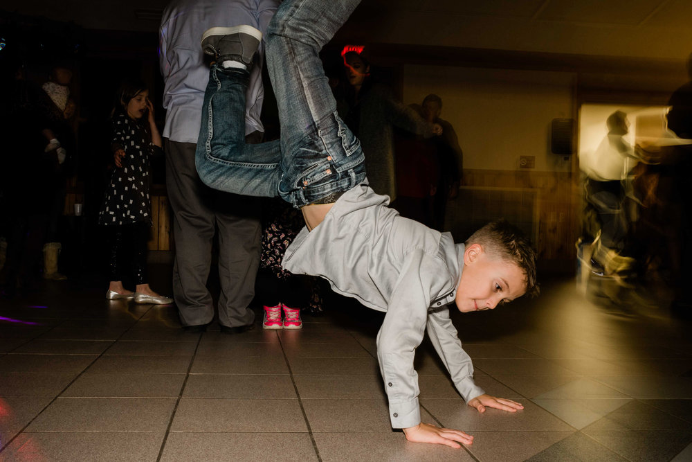 Wedding guest does handstand on the dance floor