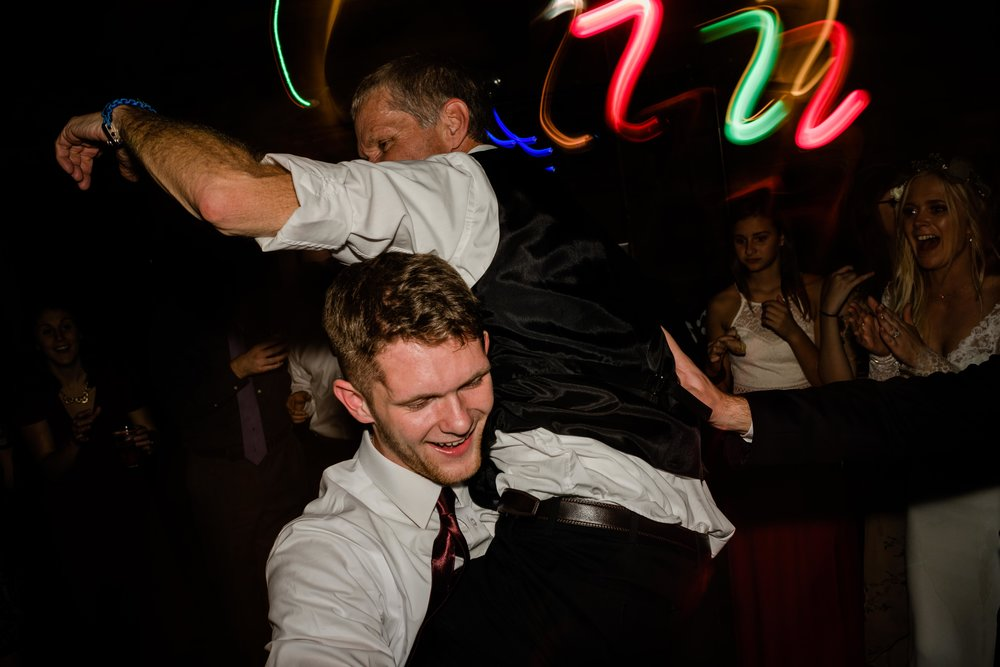 Wedding guest picks up father of the groom