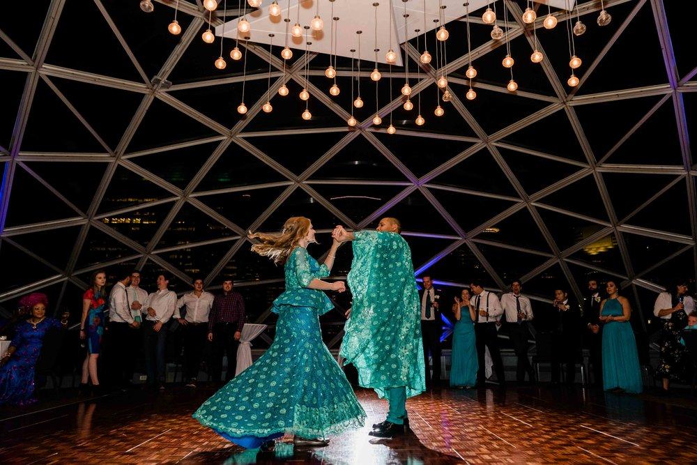 Groom spins bride around during first dance