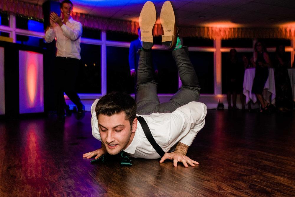 Groom doing the worm on the dance floor