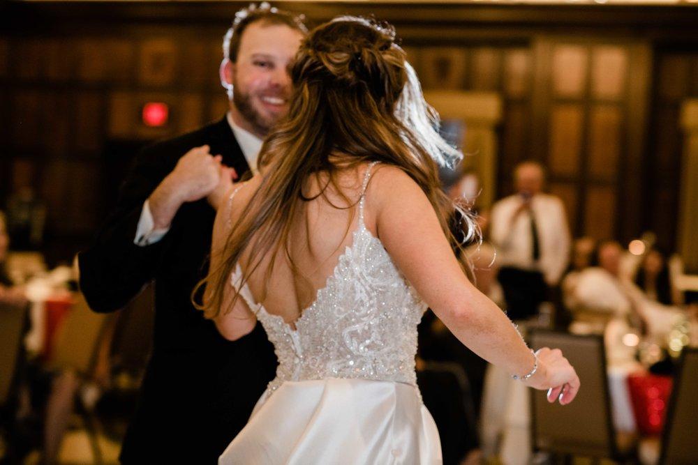 Groom twirling bride on the dance floor