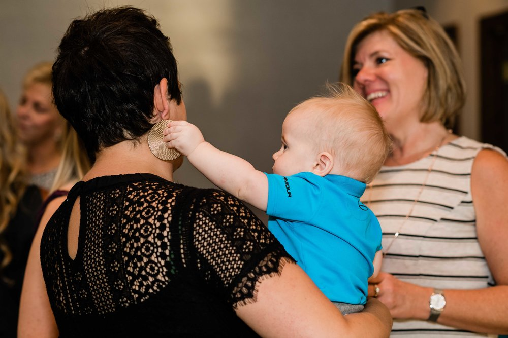 Baby plays with wedding guest's earring